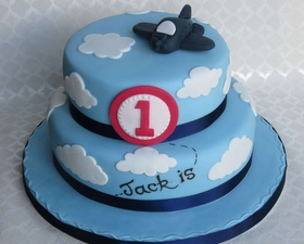 2 tier cloud cake + toy aeroplane topper