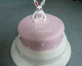 2 tier Christening cake, little toy rabbit topper
