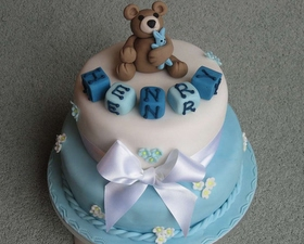 2 tier Christening cake, little teddy and building bricks topper