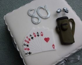Playing cards and golf cake toppers