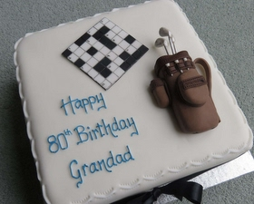 Crossword and golf cake toppers